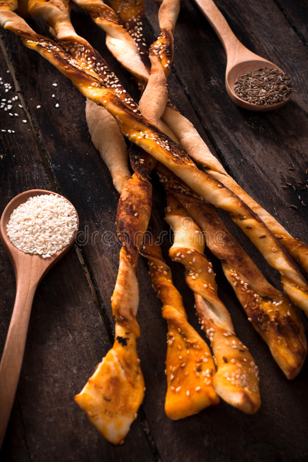Pastry sticks. With sesame and chime on wooden background,selective focus stock images