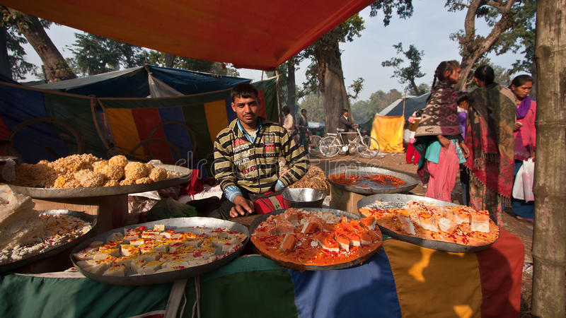 Pastry and sweet street seller in nepali fair. At Thakurdwara, Bardia, Nepal stock photography