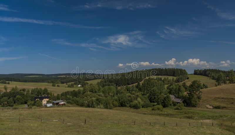 Pasture land near Kraslice town in west Bohemia. In hot blue sky day royalty free stock photo