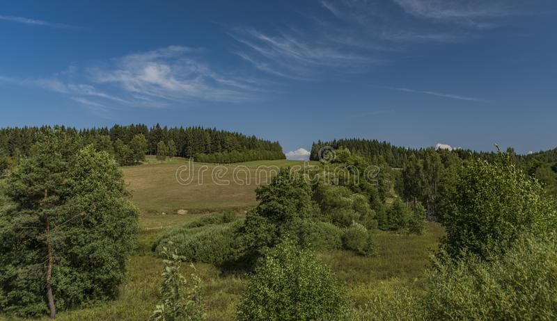 Pasture land near Kraslice town in west Bohemia. In hot blue sky day royalty free stock image