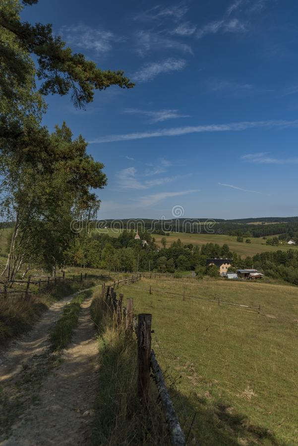 Pasture land near Kraslice town in west Bohemia. In hot blue sky day royalty free stock photos