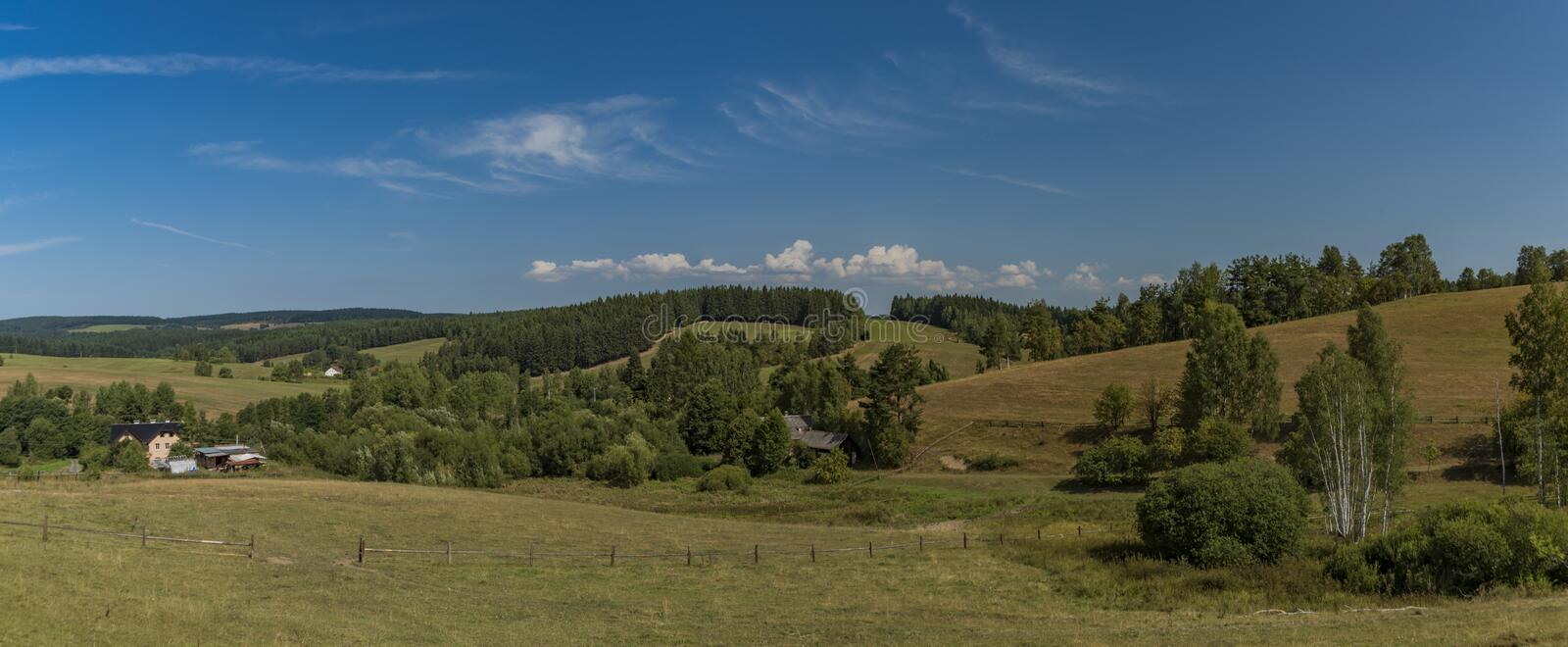 Pasture land near Kraslice town in west Bohemia. In hot blue sky day stock photography