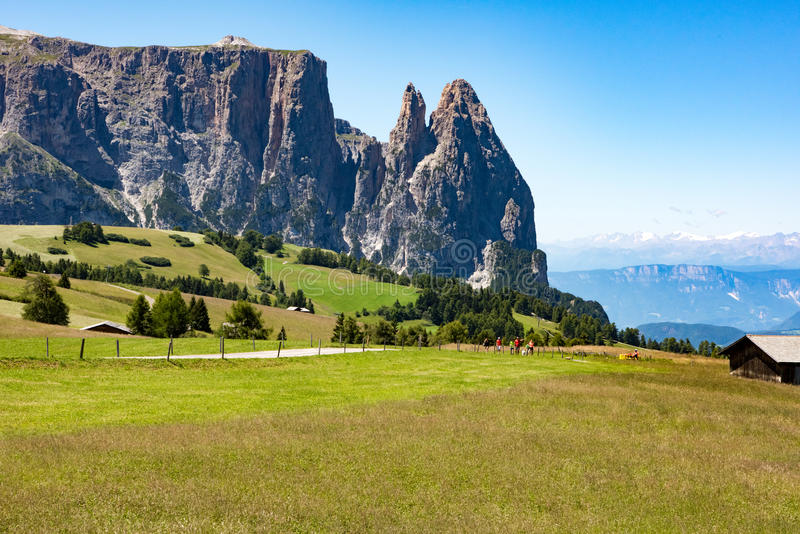 Pastures and path in front of Mount Sciliar, Dolomites, Italy stock image