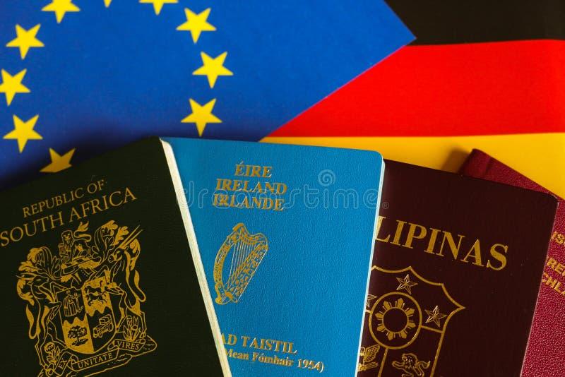 Paszporty na europejczyka i niemiec flaga fotografia stock
