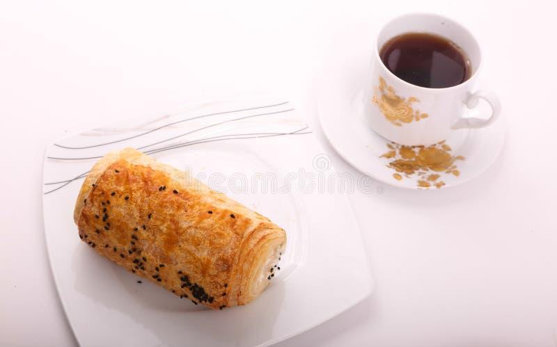 Paté with tea. On white plate on white background royalty free stock photo