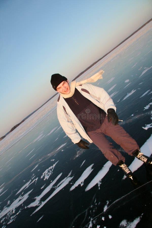 Patín en el lago imagen de archivo