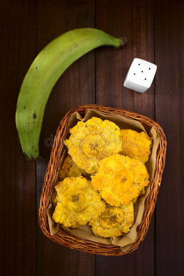 Patacon or Toston Fried Green Plantain. Patacon or toston, fried and flattened pieces of green plantains, a traditional snack or accompaniment in the Caribbean royalty free stock photos