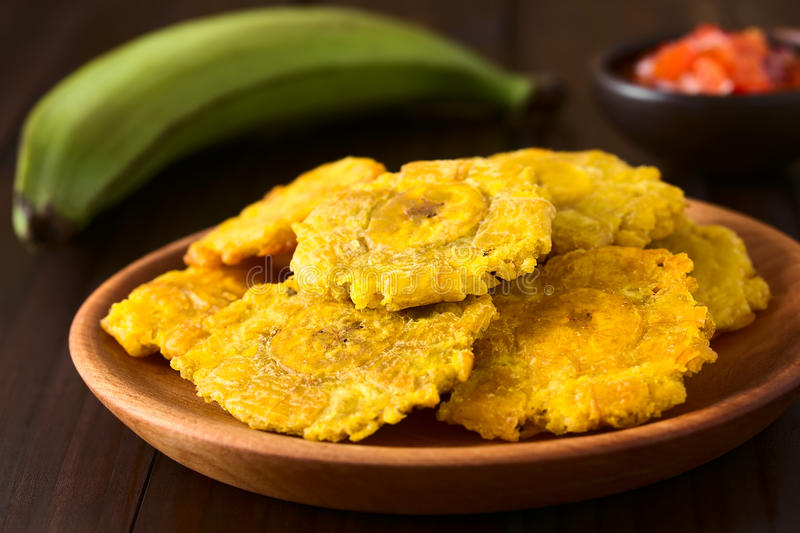 Patacon or Toston Fried Green Plantain. Patacon or toston, fried and flattened pieces of green plantains, a traditional snack or accompaniment in the Caribbean royalty free stock images