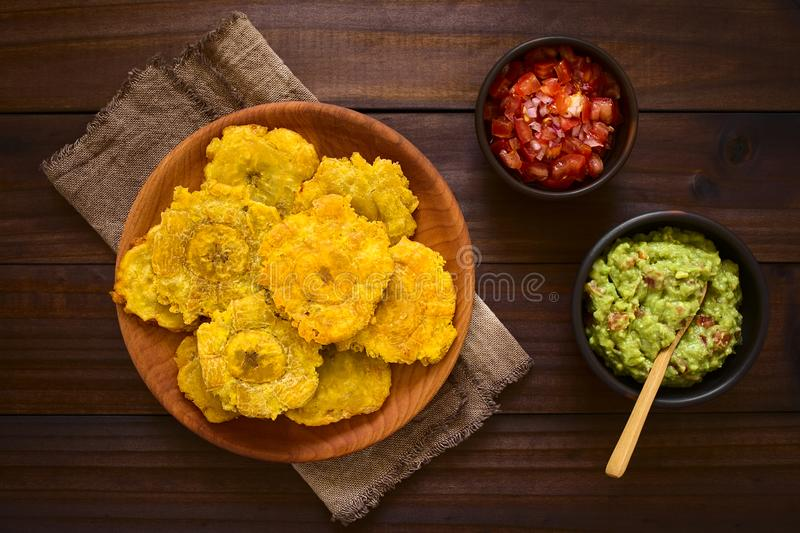 Patacon or Toston Fried Plantain Slices. Patacon or toston, fried and flattened pieces of green plantains, a traditional snack or accompaniment in the Caribbean royalty free stock photo