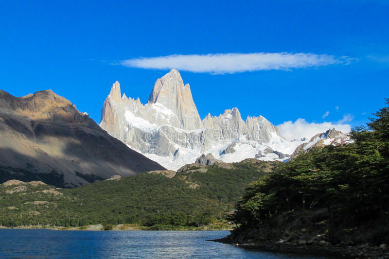 Patagonia Andes Fitzroy mountain and lake. Patagonia Andes. Rocky summit of beautiful Cerro Chalten Fitzroy mountain range in El Chalten village, in the Southern stock photo