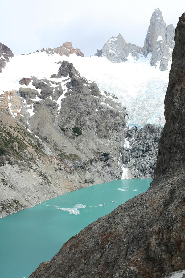 Patagonian mountains, glacier, and lake. Looking down to Laguna Sucia, almost 1000 feet below, from Laguna de los Tres in Los Glaciares National Park, Argentina royalty free stock image