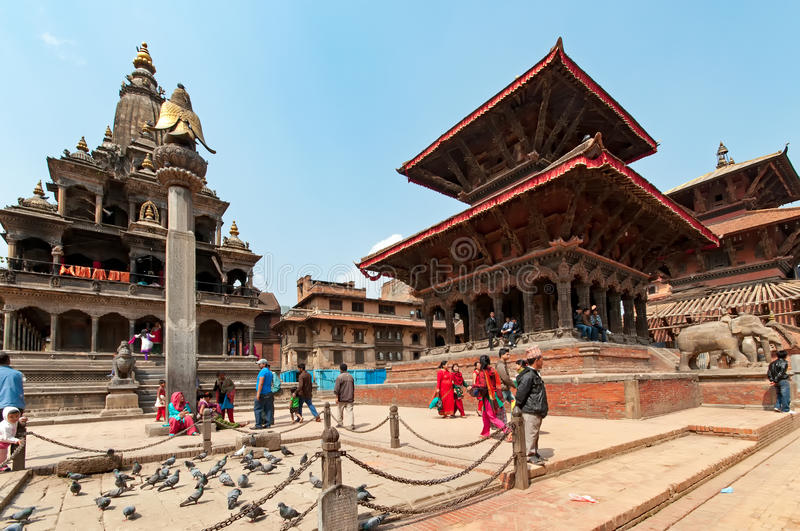 Patan Durbar Square. Kathmandu, Nepal - March 09, 2013: People walking at Kathmandu Durbar Square. Durbar Square is the generic name used to describe plazas and stock images