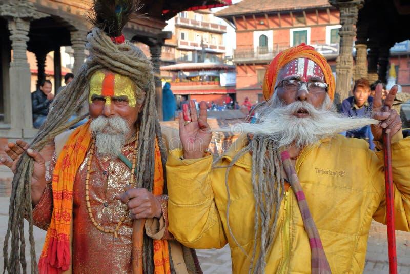 PATAN, NEPAL - DECEMBER 21, 2014: Portrait of two Sadhus Holy men at Durbar Square royalty free stock images