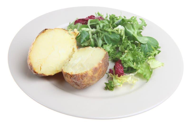 Patata cocida al horno llano fotografía de archivo libre de regalías