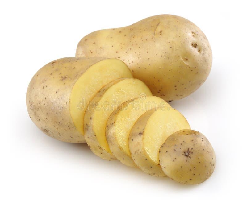 Patata cruda e patata affettata fotografie stock