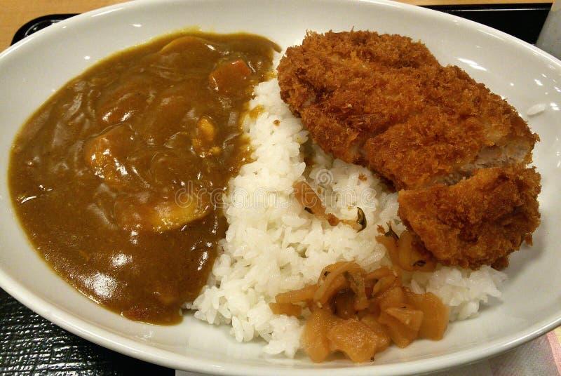 Patata de curry y cerdo frito con arroz imagen de archivo libre de regalías