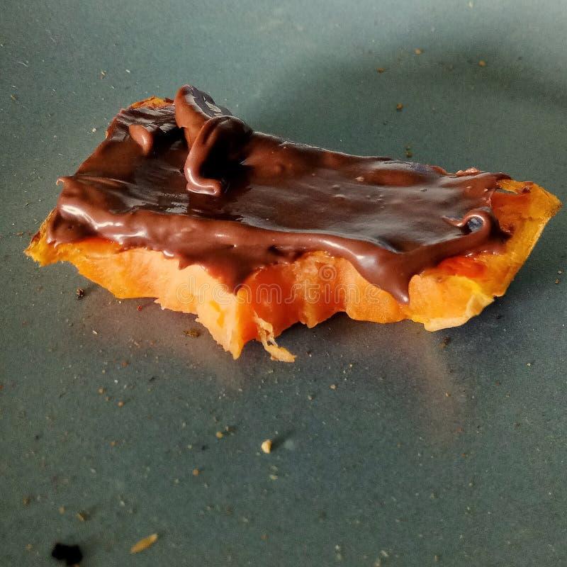 Patata dulce con la extensión del cacao imágenes de archivo libres de regalías