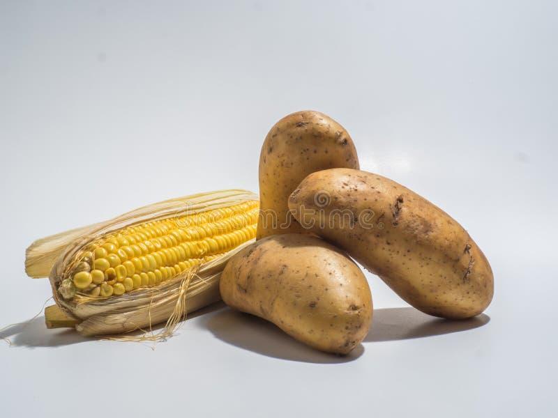 Patata y maíz foto de archivo libre de regalías