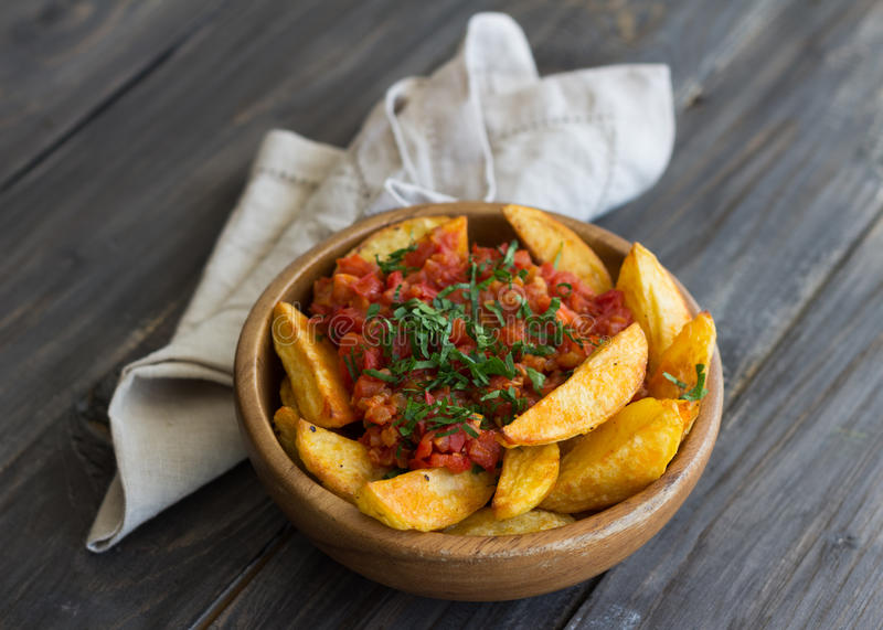 Patatas Bravas, baked potatoes with spicy tomato sauce stock photos