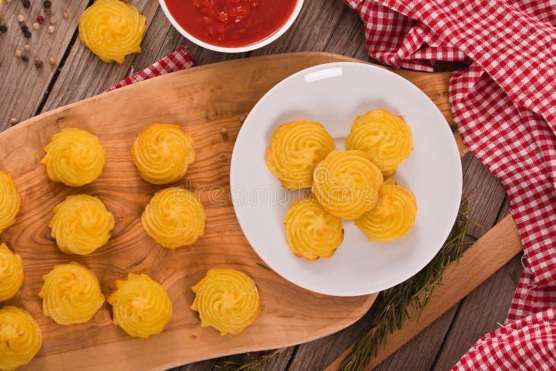 Patatas de la duquesa foto de archivo