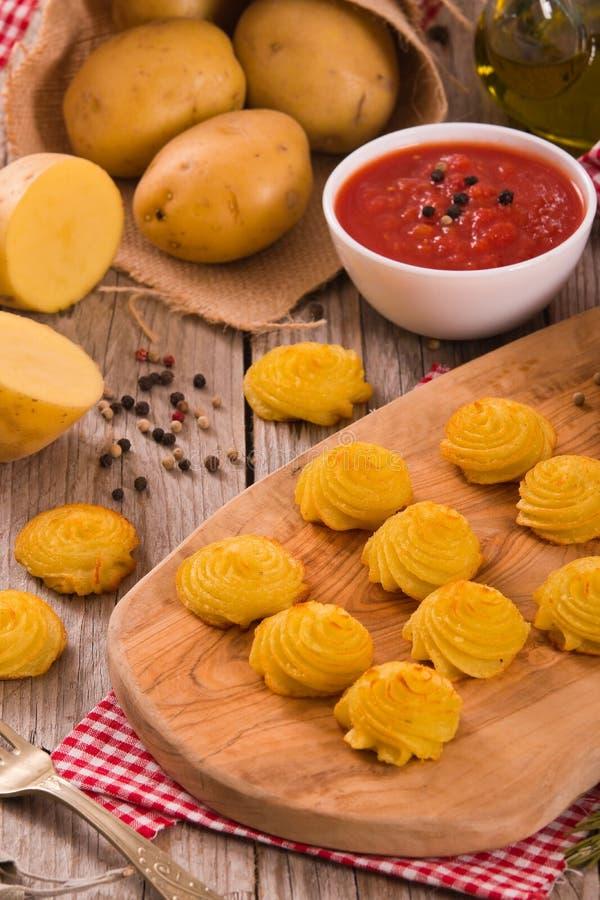 Patatas de la duquesa imagenes de archivo