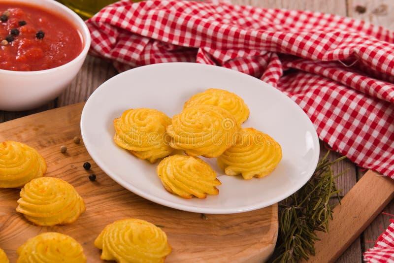 Patatas de la duquesa fotos de archivo