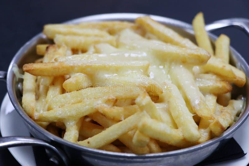 Patatas fritas caseosas fotos de archivo