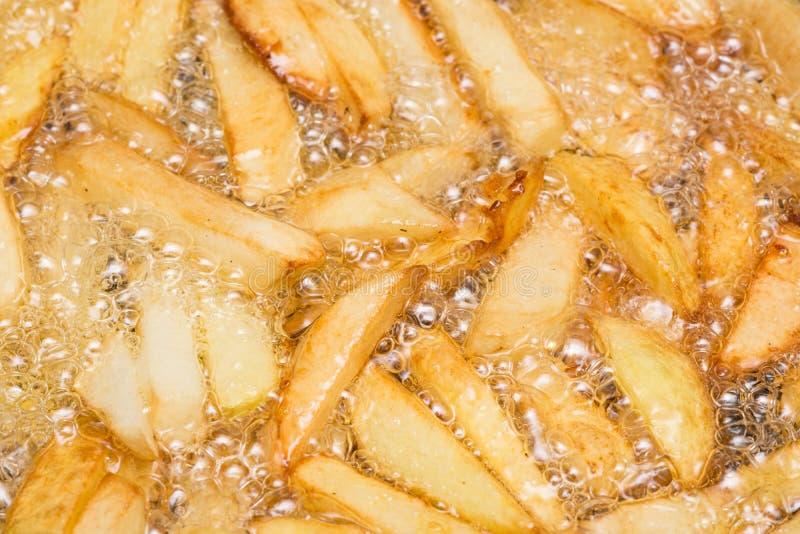 Patatas fritas de ebullición imagen de archivo