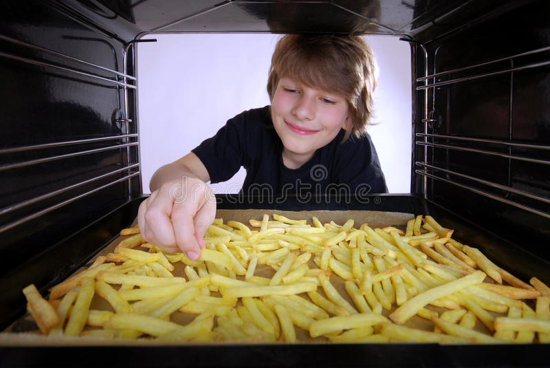 Patatas fritas de la hornada fotografía de archivo