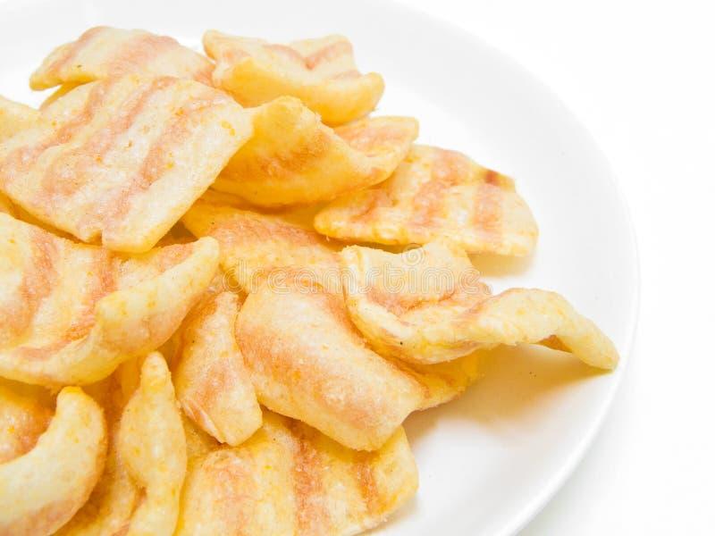 Patatas fritas de la paprika. imagen de archivo