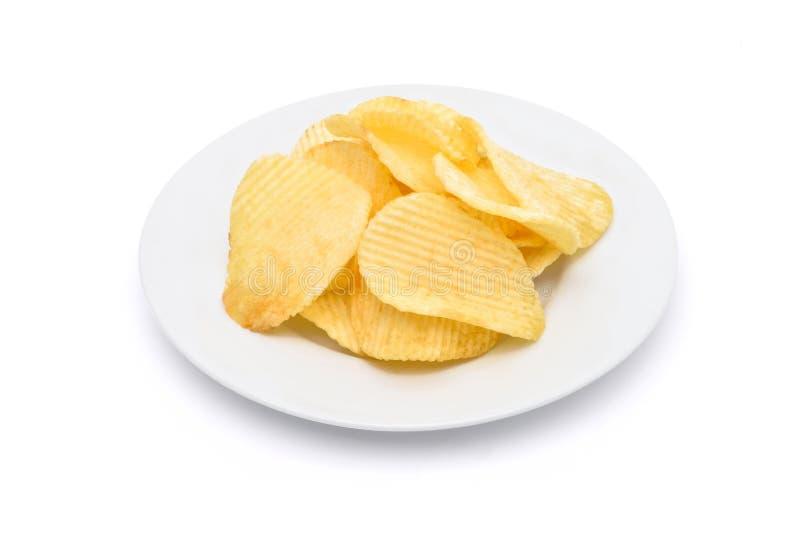 Patatas fritas en la placa blanca imagen de archivo