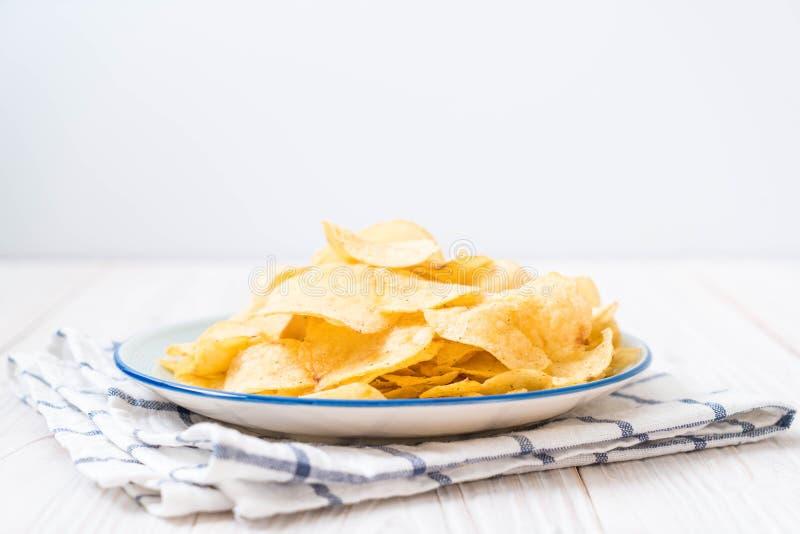 Patatas fritas en la placa foto de archivo