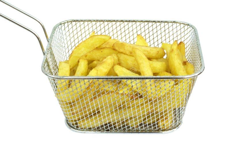 Patatas fritas en sartén profunda fotos de archivo