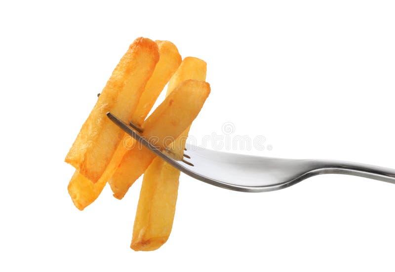 Patatas fritas en una fork imagen de archivo libre de regalías