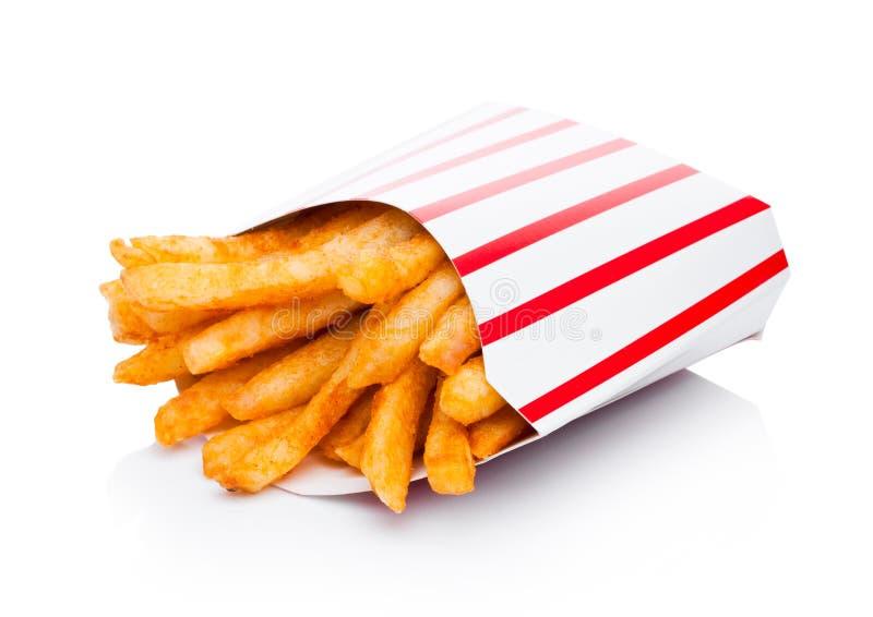 Patatas fritas meridionales en el envase de papel en blanco imagenes de archivo
