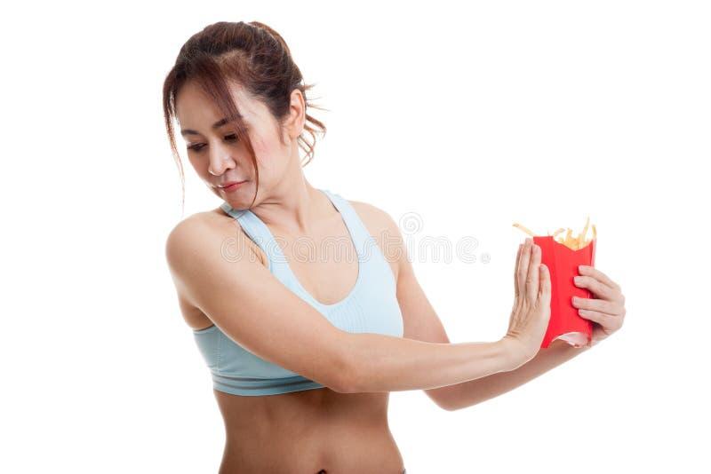 Patatas fritas sanas asiáticas del odio de la muchacha, comida basura imagen de archivo