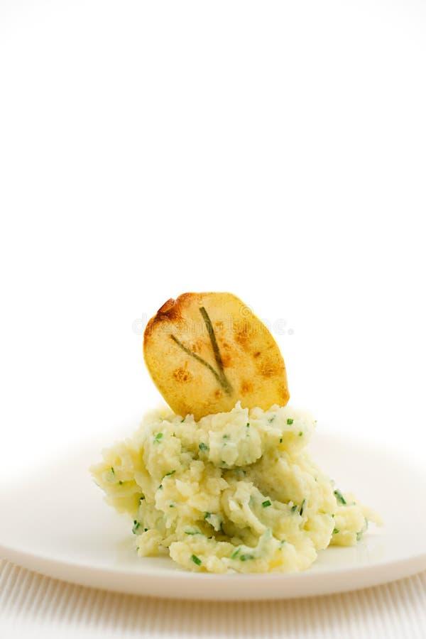 Patatas trituradas con la viruta foto de archivo