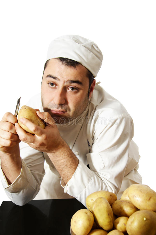 Patate alesate della sbucciatura del cuoco unico fotografie stock libere da diritti