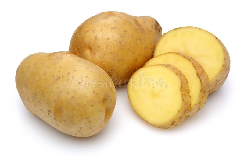Patate crude e patate affettate fotografie stock libere da diritti