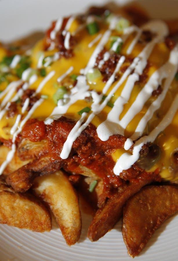 Patate fritte caricate ultime fotografie stock libere da diritti