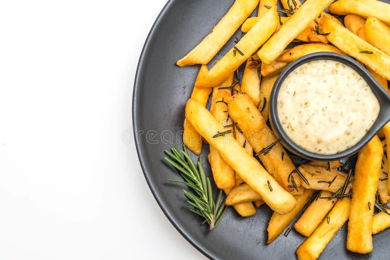 Patate fritte con salsa fotografia stock