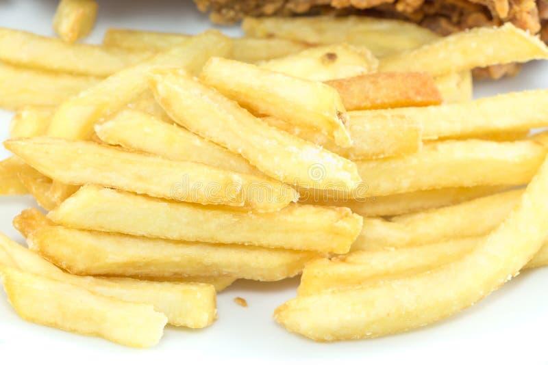 Patate fritte e dita impanate del pollo fotografia stock libera da diritti