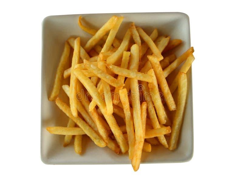 Patate fritte nel piatto isolato su fondo bianco immagine stock