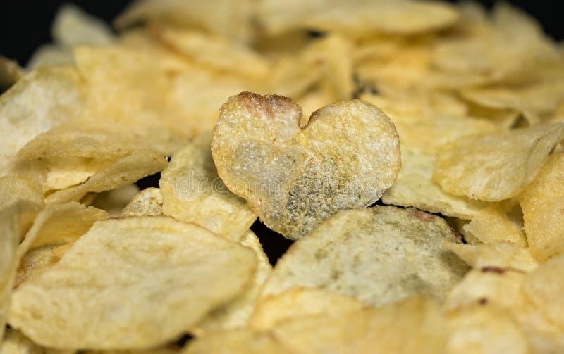 Patatine fritte nella forma del primo piano del cuore fotografia stock libera da diritti