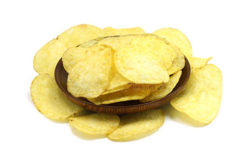 Patatine fritte in un piatto di legno immagine stock