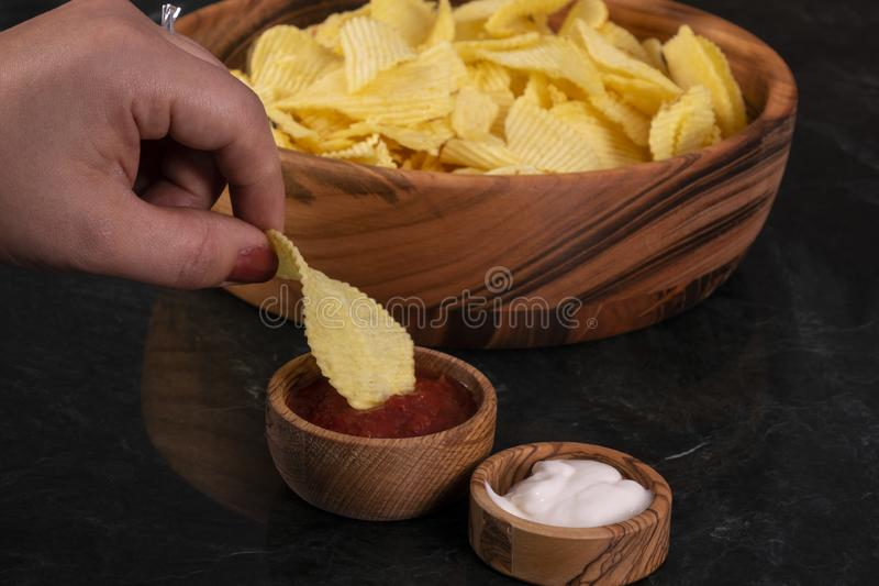 Patato chips recipe. natural fried crisps in a bowl. royalty free stock photos