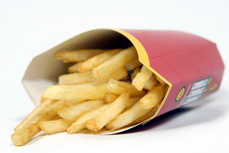 Patatoes (fritadas) do francês (profundidade pequena da agudeza) imagem de stock royalty free