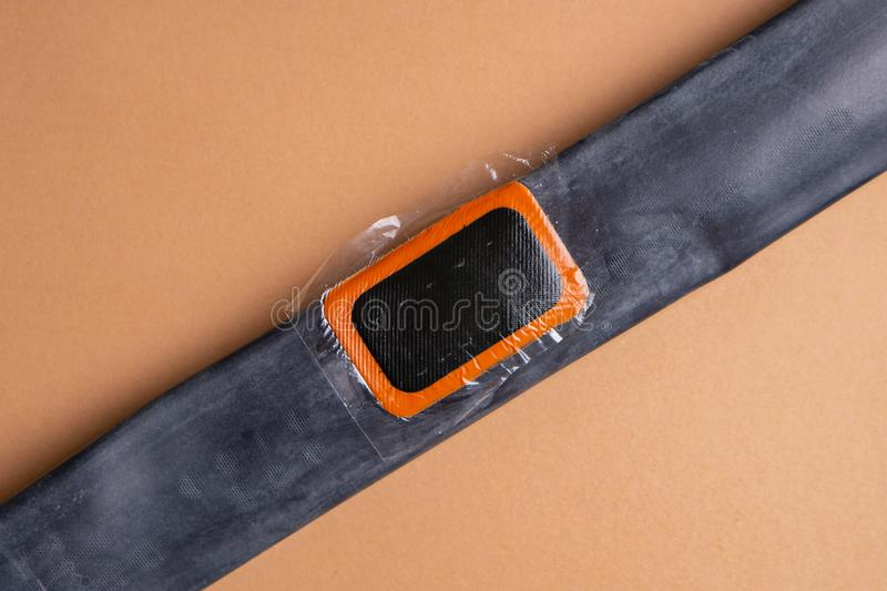 Bicycle repair kit, wheels camera on wooden background. Patch on the camera of the bike. Patch on the camera of the bike. bicycle repair kit, wheels camera on stock photos