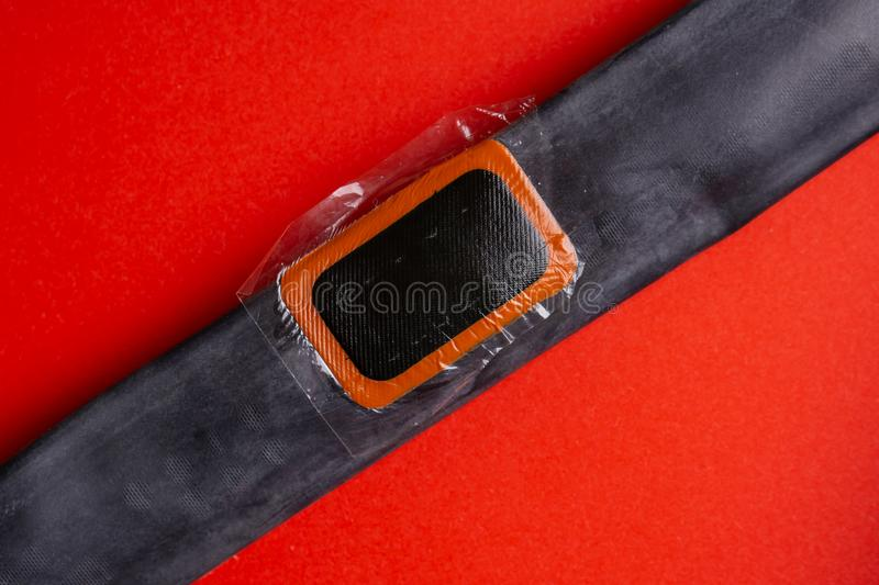 Bicycle repair kit, wheels camera on wooden background. Patch on the camera of the bike. Patch on the camera of the bike. bicycle repair kit, wheels camera on stock image