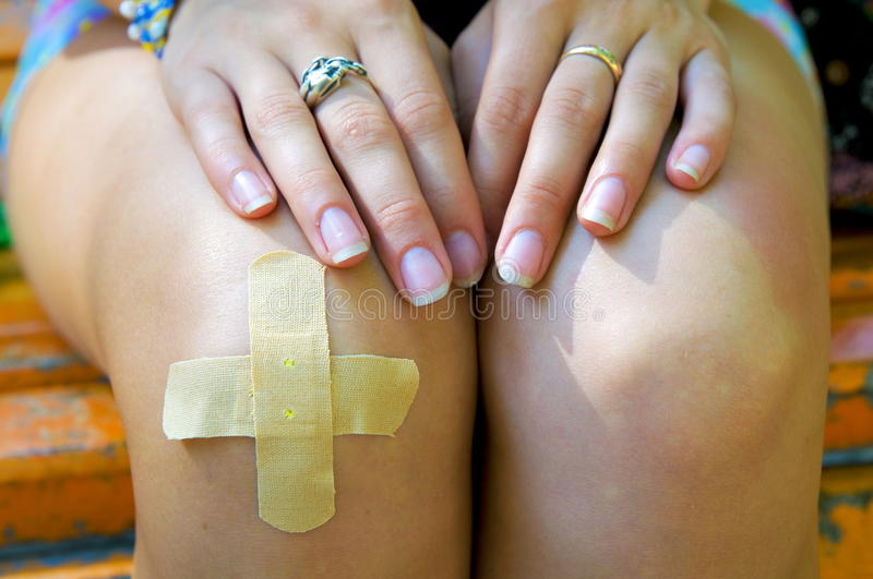 The patch on knee. royalty free stock images